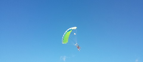 Blue sky and parachute